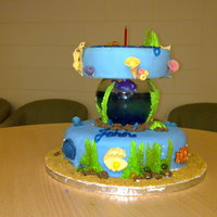 Under The Sea Birthday Cake This is my son's First Birthday Cake. Bottom tier is chocolate with PB frosting. Top tier is gluten free orange cake. Everything is...