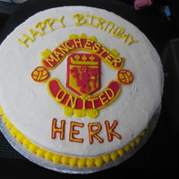 Man. United Birthday Cake This cake was made for a friend who is a serious Man U fan! The logo is made with fondant and the rest of the decorations are buttercream...