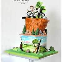 Love For Biking And Pens Painted Cake...Cake Decorating as an art? Used the cake covered in fondant as my canvass and edible food gel to paint a landscape view on...