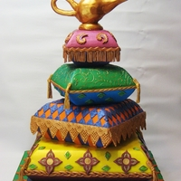 "Arabian Pillow Cake Pillow cakes ""bedazzled"" with genie lamp topper"