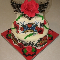 Ed Hardy-Ish Tattoo Cake This was for my 15 year old daughter who desperatel wanted a tattoo for her birthday (a REAL one). She got a tattoo cake, lol. She likes Ed...