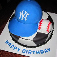 "Cake For A Soccer Player Who Loes The Yankees Bottom Is A 10 Round Covered In Buttercream With Black Fondant Accents Hat Is A 6 Round  Cake for a soccer player who loes the yankees. Bottom is a 10"" round covered in buttercream with black fondant accents. Hat is a 6&..."