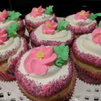 Pink And Purple Sparkles With Royal Icing Flowers Funfettic Cupcakes with Buttercream Frosting and Royal Icing Flowers.