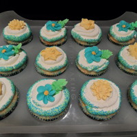 Blue, Green And Yellow Birthday Cupcakes For My Niece. Funfetti cupcakes with buttercream frosting, royal icing flowers and green and blue sugar sprinkles.