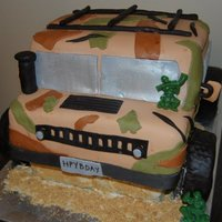 Army / Camo Hummer Cake Chocolate cake covered in MMF. All details in MMF. Army men are gummies. TFL!