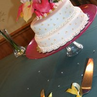 Tropical Traditional This is a bridal shower cake i made for my sister in law. The cake was golden butter filled with homemade buttercream and covered with MMF...