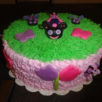 Lady Bug Cake  This is a pink and purple lady bug cake for a 1st birthday. The smash cake is purple and pink like the invitation. Buttercream icing with...