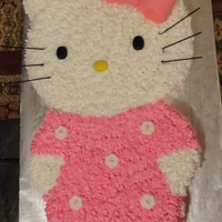 Hello Kitty   This is my first Hello Kitty cake! I used 2 round cake pans. It was a fun cake!!