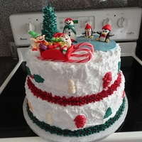 Christmas Cake  My first Christmas cake. The frosting I applied with a sponge. It is the easiest way to go. The Christmas tree is an ice cream cone and the...