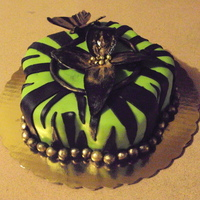 Zebra Stripe On Green This is a practice cake I made today in which I tried my hand at doing zebra stripes. I then decorated it with things that I had already...