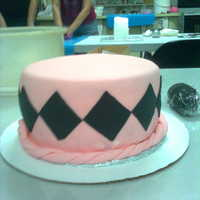 Pink With Black Diamond Shapes This is my very first fondant covered cake. It had an small Eiffel Tower on top but I forgot to take a picture of the finished cake.