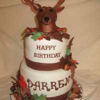"Hunting Birthday Cake  8"" and 6"" chocolate cake with cookies and cream filling. Deer head is made from rice krispies. Leaves are fondant and acrons are..."