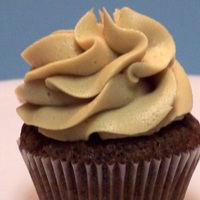 Mocha Bliss Chocolate mini cupcake with a mocha buttercream swirl. I used a Wilton 2D large tip to make the swirl.