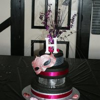 Hayley's 21St Masquerade Cake I had a friend request a copy of a cake i had previously designed, with the only difference being she wanted a mask theme instead of...