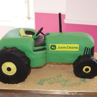 John Deere Tractor Chocolate cake with peanut butter filling covered in fondant. First time making a vehicle of any kind!