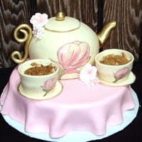 Teapot Cake I made this for my nieces 6th birthday. The little teacups are cupcakes and the tea inside is buttercream. The flowers were hand-painted. I...