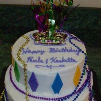 "Mardi Gras Birthday Bottom tier is a 10"" Chocolate, top is 8"" Strawberry, butter cream icing with MMF accents. I found the beads at a local store and..."