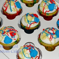 Splatter Paint Cupcakes Confetti cupcakes with vanilla buttercream. For a birthday party being held at an art studio.