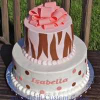 "Tiger Stripes & Polka Dots Bottom 10"" tier is strawberry cake covered and filled with lemon buttercream. Top 6"" tier is chocolate cake covered and filled..."