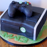Xbox Call Of Duty Modern Warfare 3 Cake My husband is obsessed with Modern Warfare 3 so I decided to surprise him with this for his birthday. :) It is covered in black satin ice...