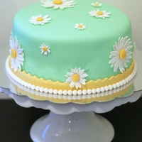 Daisy Cake I made this for a friend's birthday. Handmade daisies are super easy. :)