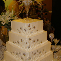 "Square Buttercream Wedding Cake With Fondant And Jewels Square buttercream cake with marshmallow fondant ""snakes"" or squiggles accented with large jewels. Silver luster dust on fondant..."