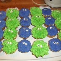 Monster Cupcakes For my son's grade 3 class on Hallowe'en. Vanilla cupcakes iced with purple buttercream using grass tip, and green buttercream...