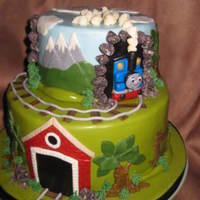 "Thomas The Train this was a 10"" choc. cake with choc mousse filling and a 6"" choc cake with choc mousse filling. It is covered with BC and MMF...."