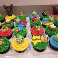 Angry Birds Cupcakes I made these for a friend's daughter. The birds, pigs, nests and sling shots are made from fondant.