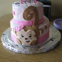 Monkey   This cake is covered in buttercream frosting with MMF decorations