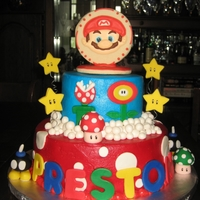 Mario Brothers This is a two tiered chocolate cake filled with chocolate BC. MMF decorations. The cake topper is a two-sided decorated sugar cookie. Mario...