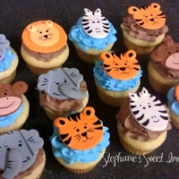 Jungle Animal Cupcakes Hand painted fondant jungle animals. Had a lot of fun making these!