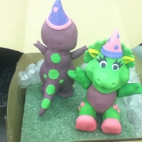 Purple Dinosaur And Green Baby Dinosaur made with rkt and fondant