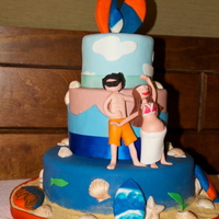 Beach Theme Baby Shower Beach theme cake. Gumpaste couple with cookie toppers representing the couple and the baby.