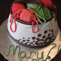 "Knitting Bag vanilla cake with marionberry buttercream. Cake is 5 layers carved from a 10"" round, 7""oval, and 8""round. Yarn balls are..."