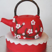 Asian Teapot vanilla cake with strawberry filling.