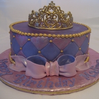 Royal Purple Princess This is cake is a rich dark chocolate filled with chocolate ganache. It is covered in MMF. The crown is made of a fondant/gumpaste blend.