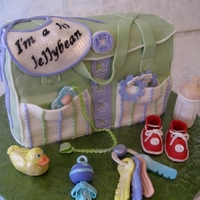 Li'l Jellybean Diaper Bag Cake This diaper bag cake is composed of two cakes. They are both dark chocolate with one being filled with peanut butter cream and the other...