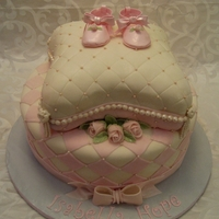 Baby Ballerina Baby Ballerina slippers atop a quilted pillow cake and bottom checkered tier with pearls and roses