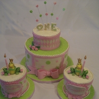 Pretty Princess Frog Cakes Pink, green and princess frog themed cakes for 1st birthday for a set of girl twins.