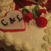 "Sweetheart Cake 6"" two layer cake in butter cream accented with MMF roses."