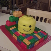 Lego My son-in-laws little brother's cake. He wanted a lego cake. The head kept colapysing so the fondant didn't come out good. But he...