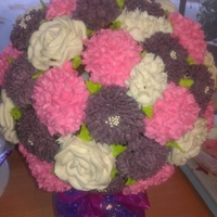 1321918776.jpg Cupcake Bouquet. My first try at it and it was gorgeous! 3 different cupcake flavors, Mayan hot cocoa w/ cinnamon cayenne marhmallow icing...
