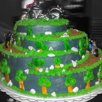 Motorcycle Mountain Cake #10 - Motorcycles not edible - everything else is. Not to happy with how the trees turned out but i guess it just added to the cartoon...