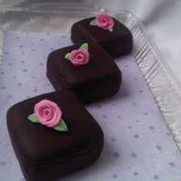 Mini Cakes This is my first try at roses and mini's. It wasn't so simple crumb coating them. I'm happy with the roses for it being my...