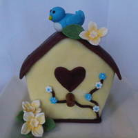 Lil Bird House This little bird house is about 4 inches tall, the bird, and the bird house are all fondant. The flowers are GP. Thanks CC for ideas. :)...