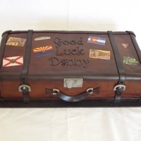 "Suitcase Cake Made from 2 8"" squares. Covered in mmf and airbrushed to give a weathered look. Stickers made from Wilton icing sheets ran thru my..."