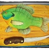Bream/bluegill Cake The cutting board is chocolate cake with caramel filling covered in chocolate ganache..The fish and knife handle are RKT covered in melted...