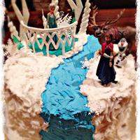 Frozen Cake Snocream icing, chocolate cake, royal icing spears, fondant spears and toffee for the palace floor.