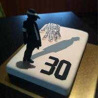 Smooth Criminal Cake Thanks for the Kudos. It's a vanilla butter cake covered in Satin Ice. I made the figure by getting a pic of the net and laying it...